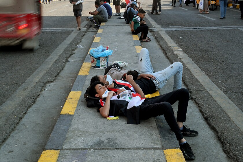 Anti-government protesters rest during ongoing protests in Baghdad, Iraq, Saturday, Nov. 2, 2019. (AP Photo/Hadi Mizban)