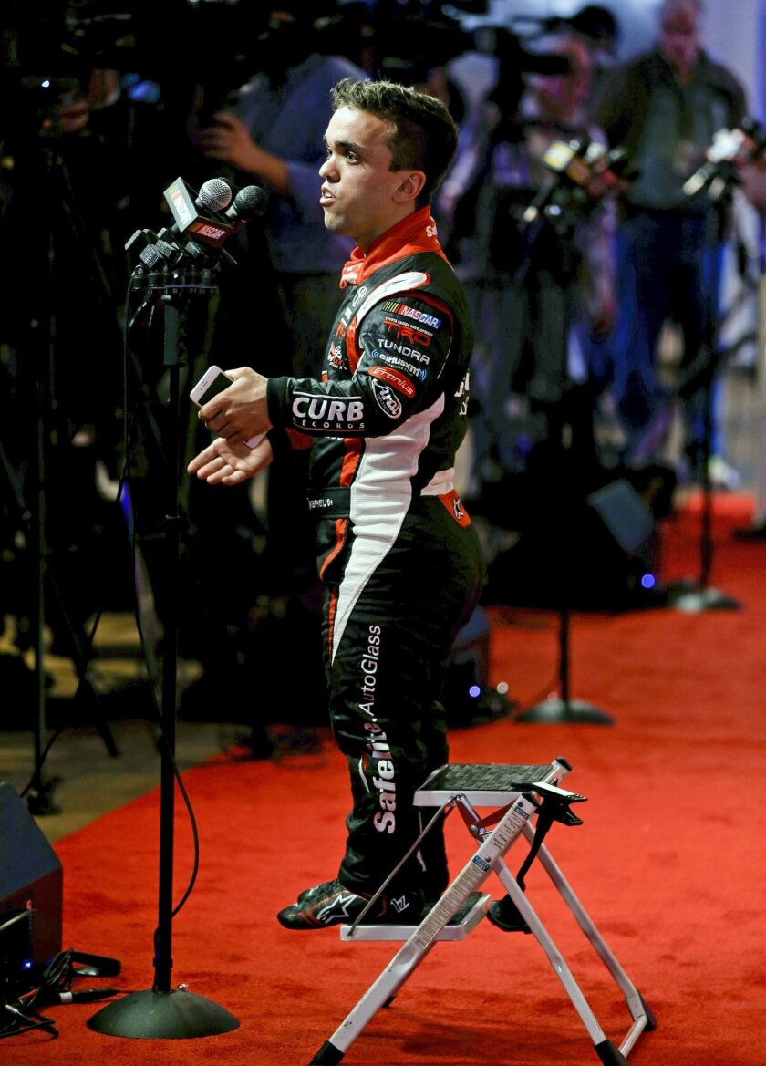 Truck series driver Rico Abreu answers questions from members of the media during NASCAR media day at Daytona International Speedway, Tuesday, Feb. 16, 2016, in Daytona Beach, Fla. (AP Photo/John Raoux)