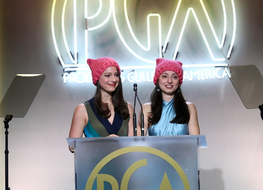 Nora Rothman, left, and Elizabeth Rothman speak at the 28th Producers Guild Awards, their pink hats a nod to the women's marches held around the world the day after Donald Trump's inauguration.