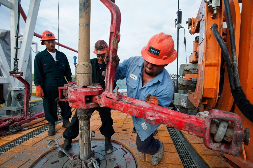 A drilling operation seeks oil and gas through fracking in Webb County, Texas. A separate operation, in north Texas, was blamed for a family's severe health problems, for which a jury awarded nearly $3 million in damages.