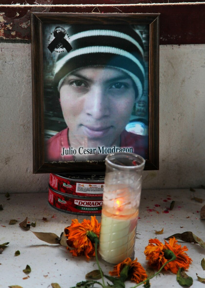 FILE - In this Nov. 9, 2014 file photo, an altar for slain student Julio Cesar Mondragon stands at his former school, the Raul Isidro Burgos Rural Normal School of Ayotzinapa, in Tixtla, Mexico. On Wednesday, Nov. 4, 2015, experts are exhuming the body of Mondgragon who was found dead with his face