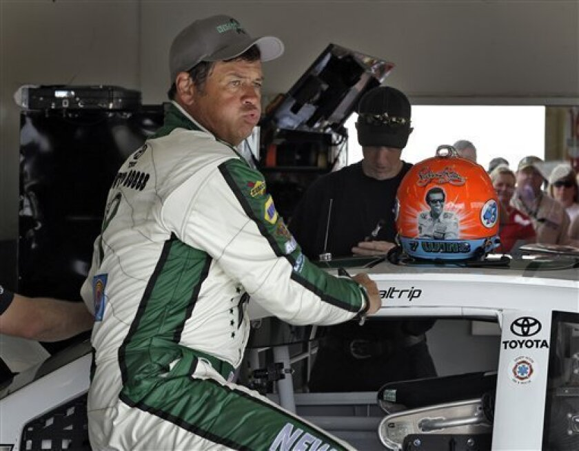 Michael Waltrip reacts as he gets out of his car during practice for the NASCAR Sprint Cup Series Daytona 500 auto race Saturday, Feb. 23, 2013, at the Daytona International Speedway in Daytona Beach, Fla. (AP Photo/Chris O'Meara)