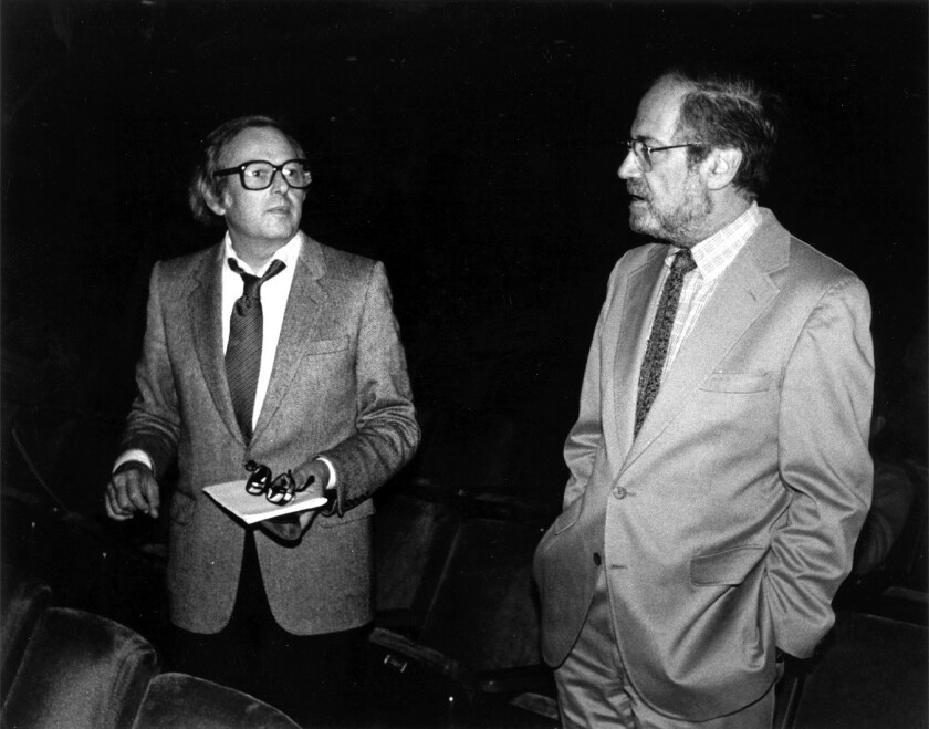 André Previn, left, with Los Angeles Philharmonic executive director Ernest Fleischmann in 1987, two years before a rift between the two resulted in Previn's resignation as music director.