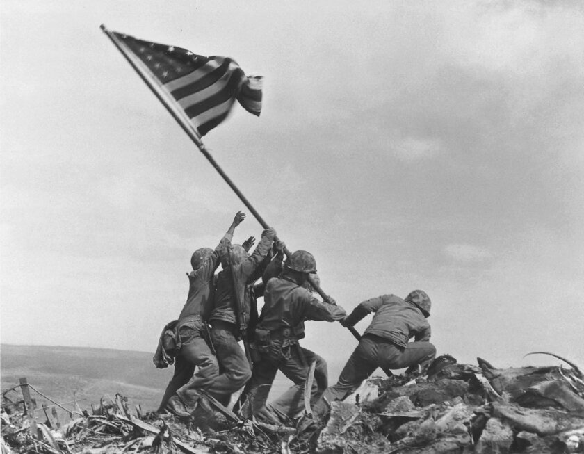 In this Feb 23, 1945 file photo, U.S. Marines of the 28th Regiment, 5th Division, raise the American flag atop Mt. Suribachi, Iwo Jima, Japan.AP Photo/Joe Rosenthal, File