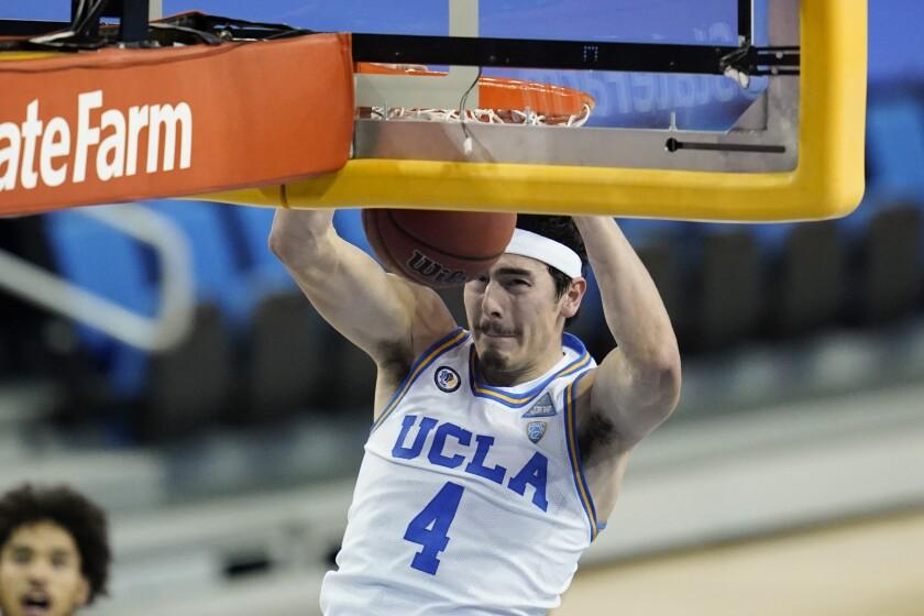 UCLA's Jaime Jaquez Jr. (4) dunks the basketball.