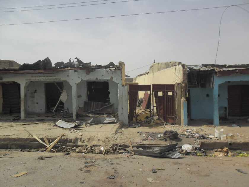 Buildings show damage following an explosion at a World cup viewing center in Damaturu, Nigeria.