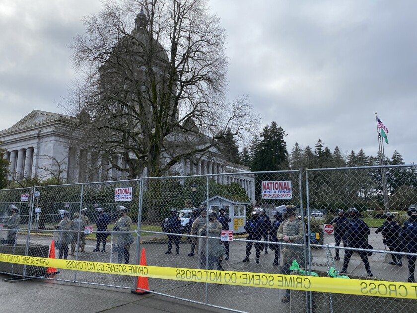 National Guard troops and state troopers guard a fenced-off Washington state Capitol in Olympia on Sunday.