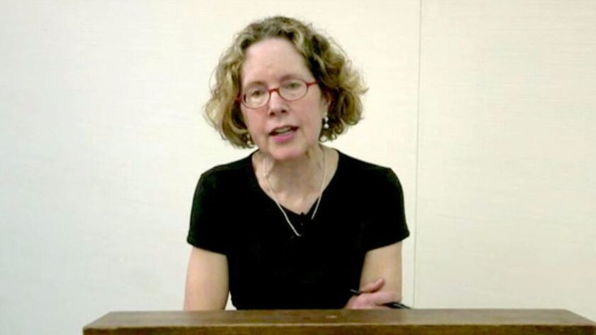 Heather Mac Donald speaks through livestream video at Claremont-McKenna College on April 6 as protesters outside block access to the auditorium.