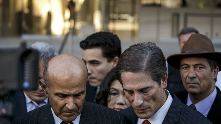 Former Los Angeles County Sheriff Lee Baca left with attorney Nathan Hochman outside federal court Thursday, in downtown Los Angeles.