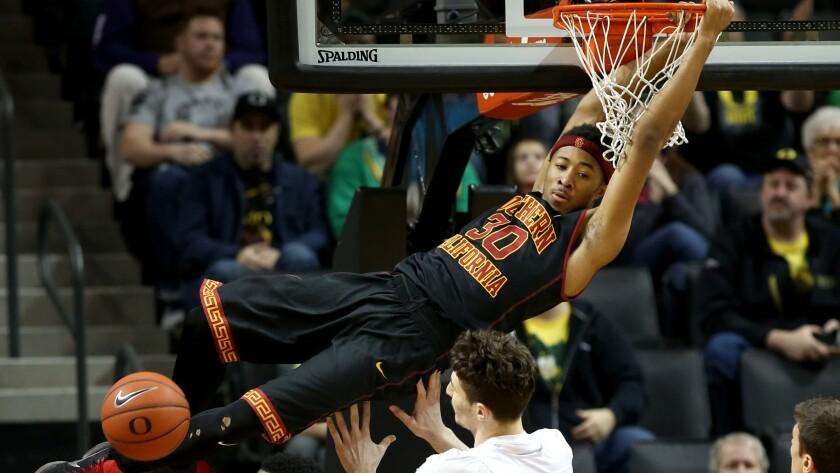 USC forward Elijah Stewart dunks against Oregon during a loss on Thursday night in Eugene.