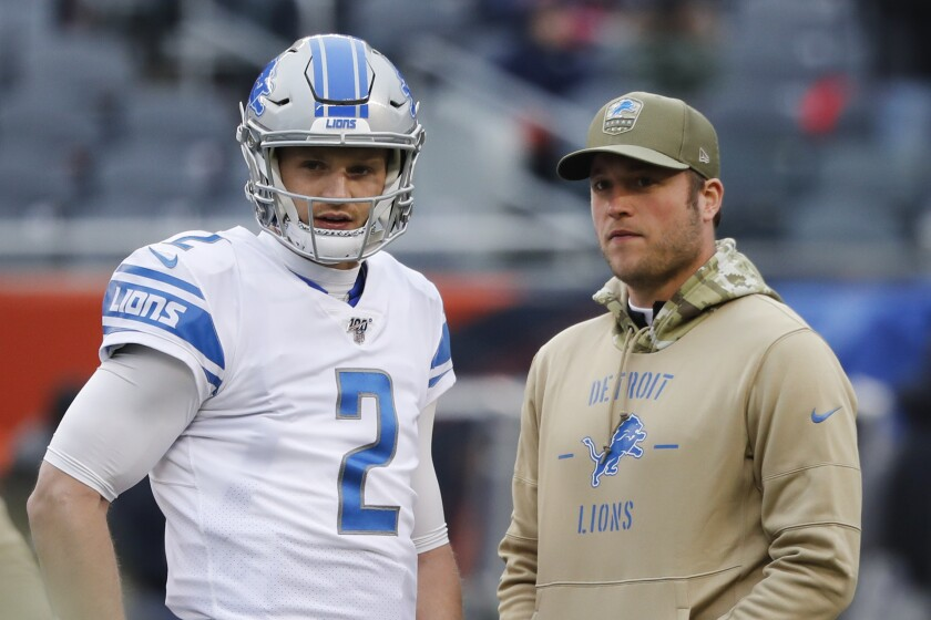 Detroit Lions quarterback's Jeff Driskel (2) and Matthew Stafford watch during warmups before an NFL football game against the Chicago Bears in Chicago, Sunday, Nov. 10, 2019. (AP Photo/Charles Rex Arbogast)