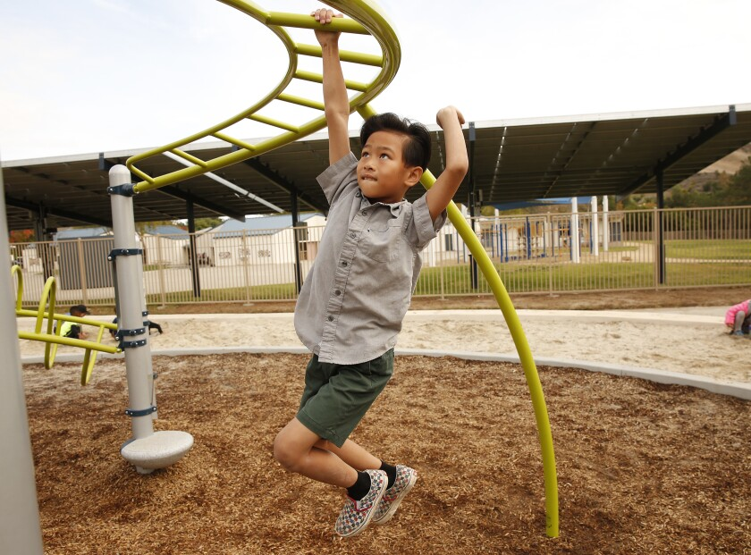 Sawyer Dinh on a playground
