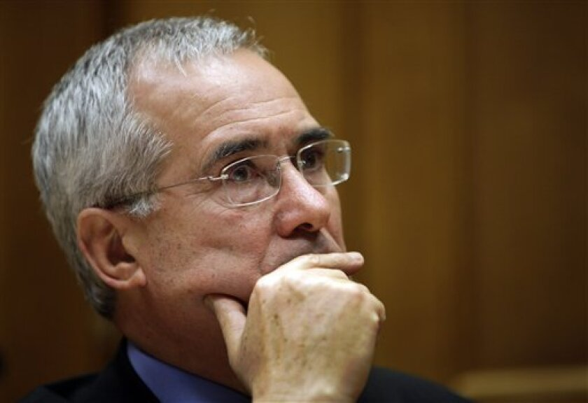 Nicholas Stern, chair of the Grantham Research Institute on Climate Change and the Environment at the London School of Economics, listens to a reporter's question during a news conference in central London, Tuesday Dec. 1, 2009. The leading British climate change economist says the science of climate change is based on sound scientific methods and those who doubt the science of global warming are 'muddled and confused.' Hackers broke into the computer systems of the University of East Anglia climate research unit last month and posted documents online. Some bloggers claim the document shows scientists have overstated the case for global warming and have attempted to manipulate data. (AP Photo/Lefteris Pitarakis)