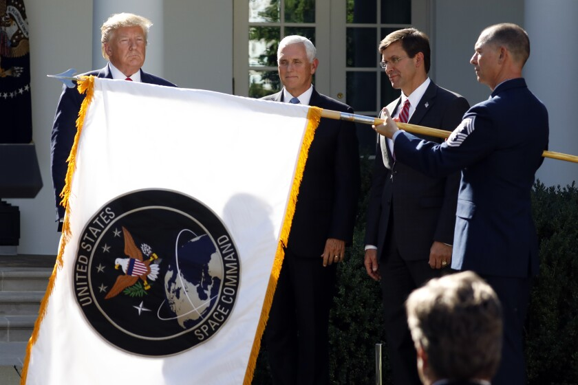 President Trump and others with Space Command flag.