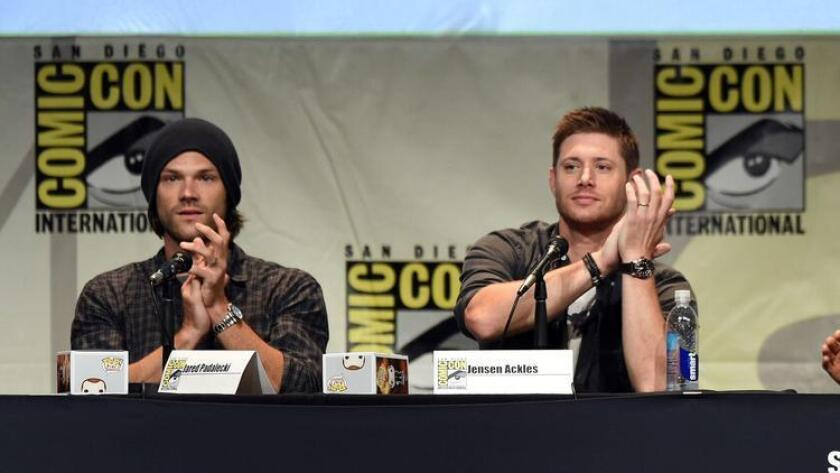 """SAN DIEGO, CA - JULY 12: Actors Jared Padalecki (L) and Jensen Ackles speak onstage at the """"Supernatural"""" panel during Comic-Con International 2015 at the San Diego Convention Center on July 12, 2015 in San Diego, California. (Photo by Kevin Winter/Getty Images) User Upload Caption: With the 12th season of """"Supernatural"""" premiering October 13, stars of the show will meet with fans Sunday at Comic-Con International (U-T File Photo)"""