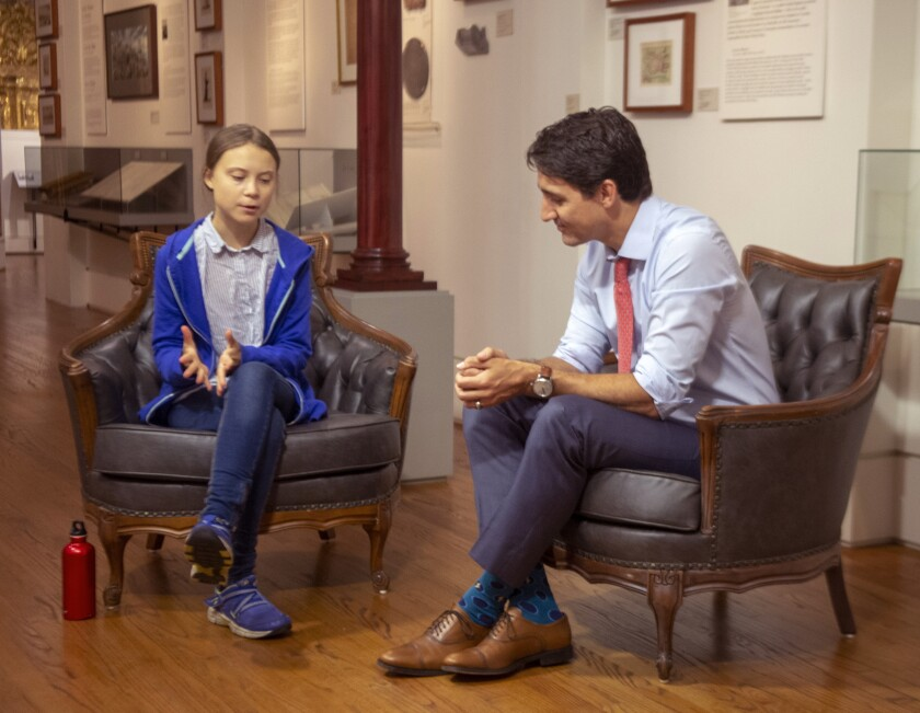 Canadian Prime Minister Justin Trudeau speaks with Swedish environmental activist Greta Thunberg.
