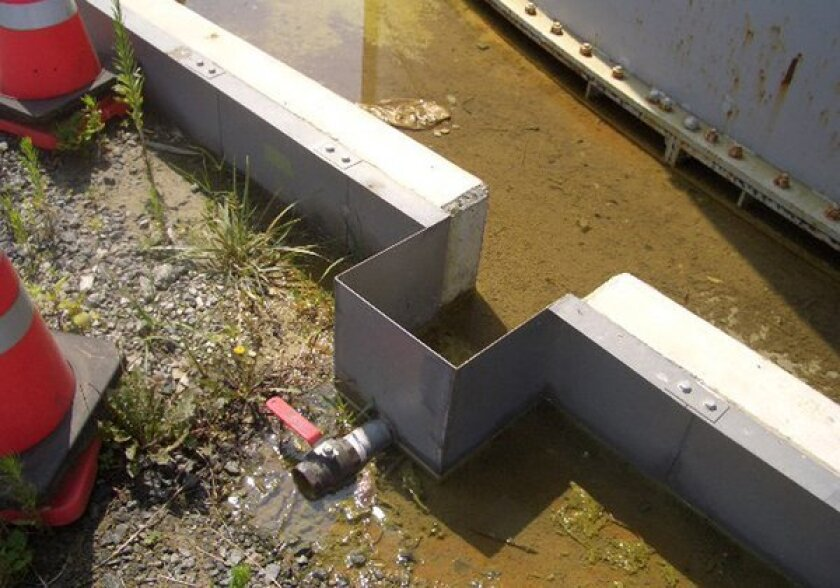 Contaminated water stands on the ground after leaking from the Fukushima Daichi nuclear power plant.