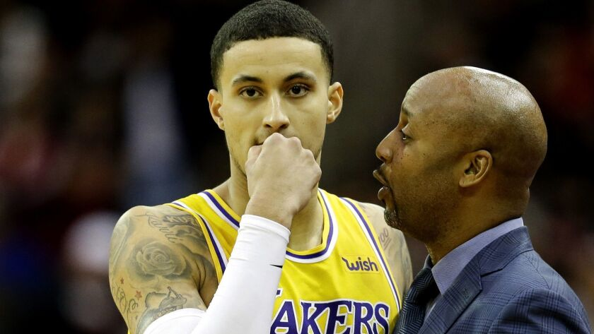 Los Angeles Lakers associate head coach Brian Shaw, right, talks with guard Kyle Kuzma during the se