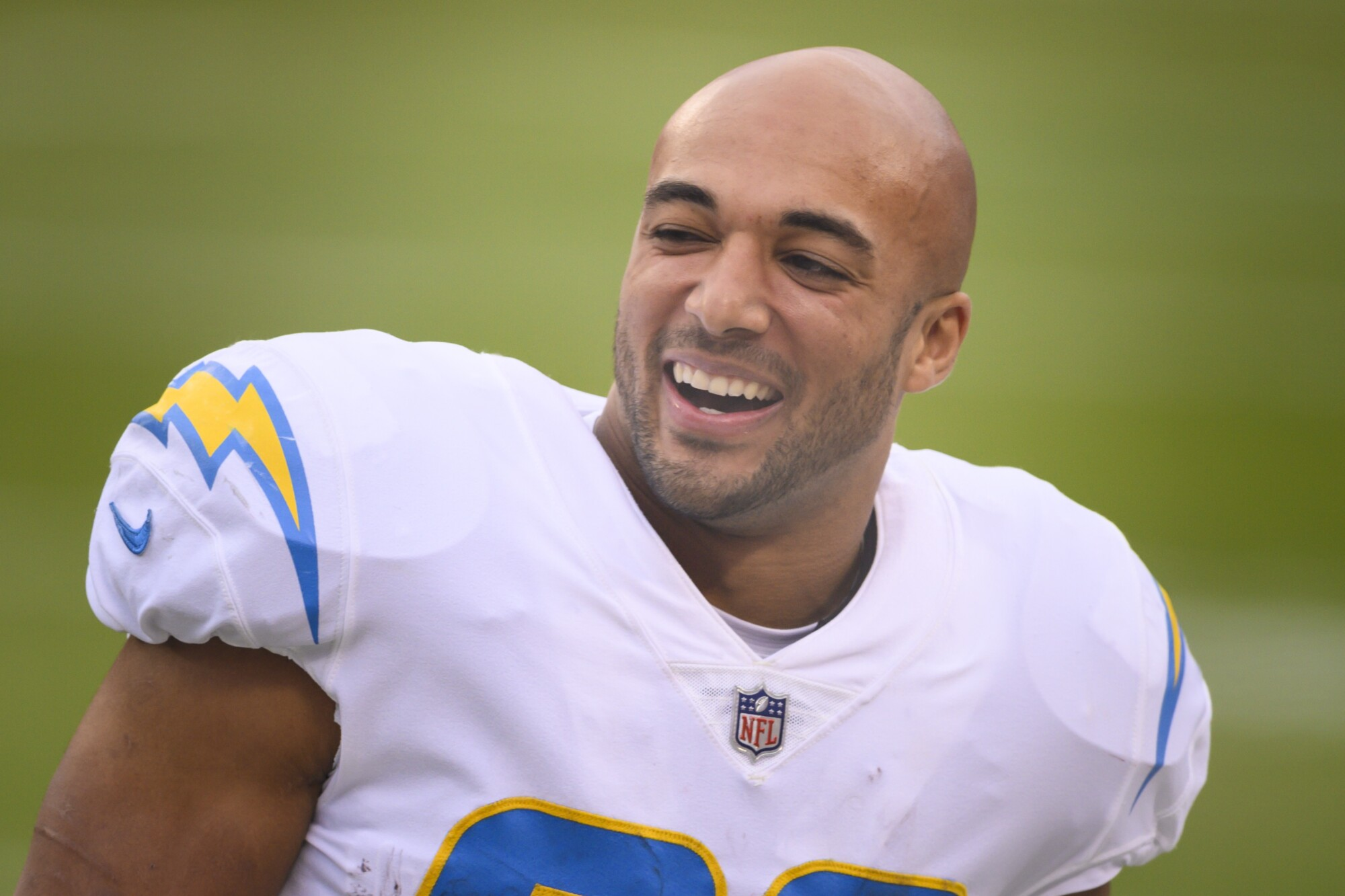 Chargers running back Austin Ekeler laughs on the sideline.