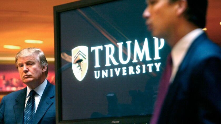 Donald Trump, left, is introduced as an educational mentor by Trump University President Michael Sexton at its 2005 launch.