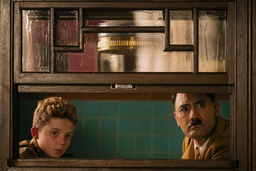 """Roman Griffin Davis and Taika Waititi in """"Jojo Rabbit."""""""