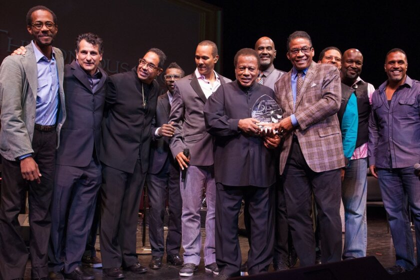 Wayne Shorter receives the Thelonious Monk Institute of Jazz Lifetime Achievement Award from Herbie Hancock surrounded by Wayne's band members Brian Blade, John Patitucci, Danilo Perez, trumpeter Roy Hargrove and members of the band Take 6.