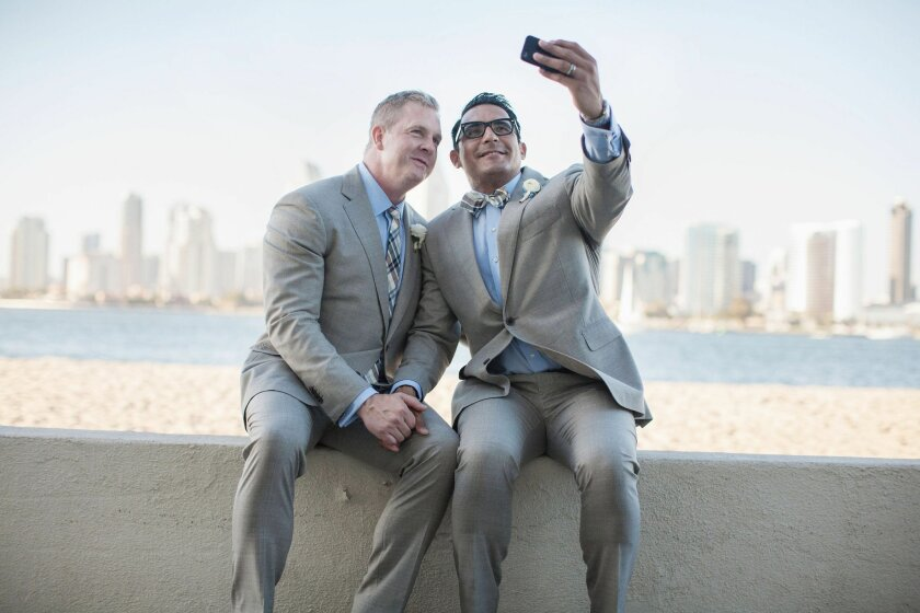 Oscar de las Salas and Gary Jackson take a selfie photo on their wedding day in Coronado. The two were married on Coronado but the ceremony was marred by someone nearby shouting homophobic remarks loud enough to be heard by the entire wedding party.