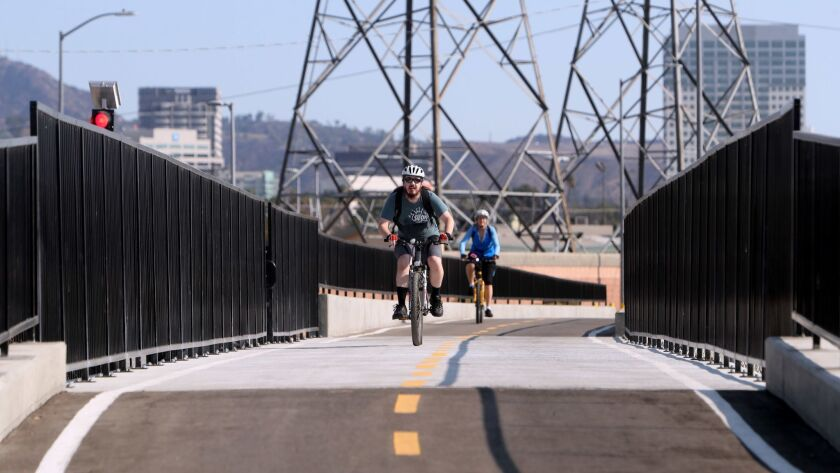 Cyclists pass over newly constructed Glendale Narrows Riverwalk Phase II pedestrian and bicycle brid
