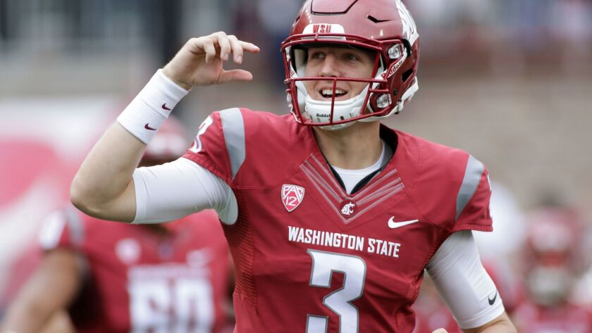 Washington State quarterback Tyler Hilinski (3) runs onto the field with his teammates before an NCAA college football game against Idaho in Pullman, Wash.
