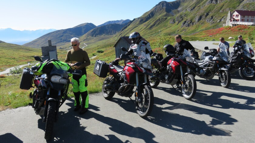 Riders gear up at Independence Mine in Hatcher's Pass, Alaska in August during a MotoQuest motorcycle adventure tour.