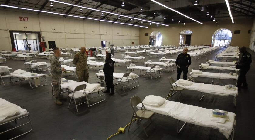 Cots are set up at a possible coronavirus treatment site April 1 in San Mateo, Calif. The National Guard is setting up the federal cache, which includes cots and personal protective equipment needed to establish a federal medical station with capacity up to 250 beds.