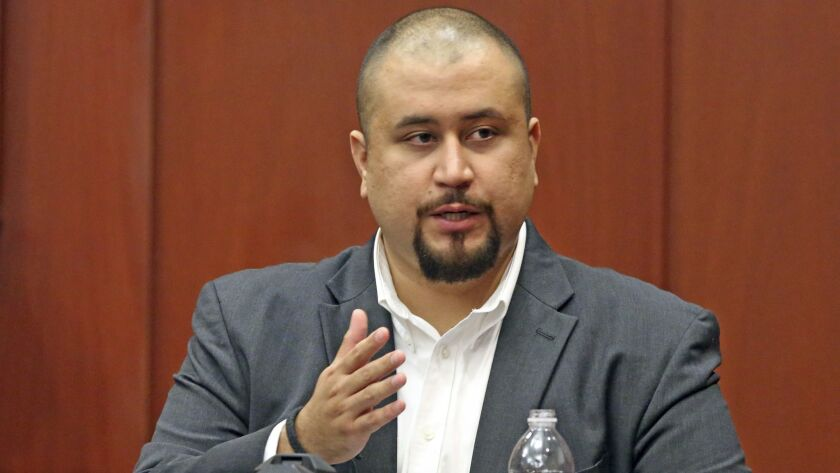 FILE - In this Sept. 13, 2016 file photo, George Zimmerman looks at the jury as he testifies in a Se