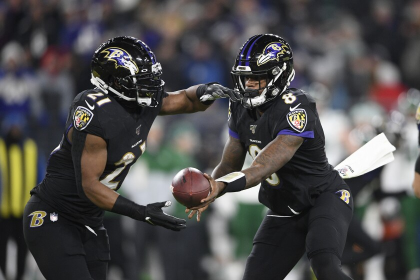 """File-This Dec. 12, 2019, file photo shows Baltimore Ravens quarterback Lamar Jackson (8) handing off to running back Mark Ingram (21) during the first half of an NFL football game against the New York Jets in Baltimore. As he draws closer to a milestone birthday, Ingram wants everyone to know he's still got what it takes to score a bunch of touchdowns, rush for 1,000 yards and earn an invite to the Pro Bowl. """"I feel like people say when you're 30 you're dead,"""" Ingram said Wednesday. """"I turn 30 at the end of this week, but my best football is ahead of me."""" (AP Photo/Nick Wass, File)"""