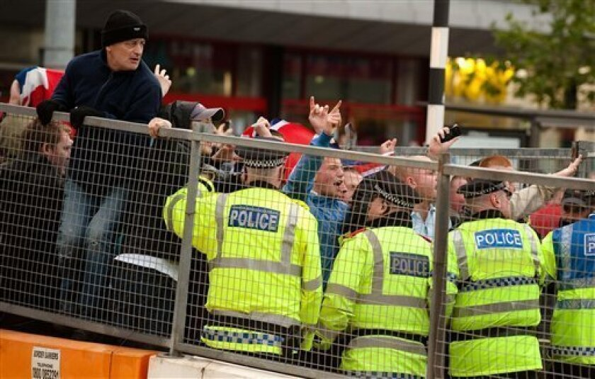 Police contain protestors in Manchester's city center, after demonstrators took to the streets in rival race protests Saturday Oct. 10, 2009. Police in fluorescent jackets stood between hundreds of anti-Islam protesters and counter-demonstrators in the English city of Manchester on Saturday, arresting 18 people in a bid to keep the peace. Police locked down a section of the city center as some 2,000 people gathered. (AP Photo/Gareth Copley/PA Wire)