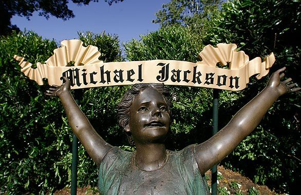 A statue greets visitors at the main entrance to Michael Jackson's Neverland Ranch in Los Olivos. Jackson's family has announced there are no plans for a funeral or burial at the ranch in Central California. But the rural former home of the pop star remains an attraction.