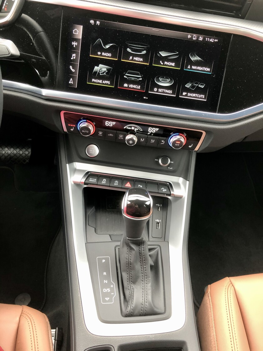 The shift console is substantial with a large e-bin for wireless charging and two USBs, one of which is a Type C.