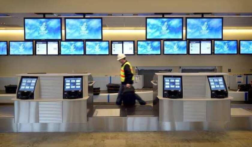 A worker walks through a terminal at John Wayne Airport.