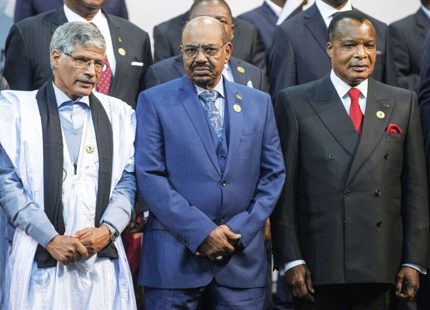 Abdelkader Taleb Oumar, prime minister of the Sahrawi Arab Democratic Republic, left, poses with Sudan's president, Omar Bashir, and Congo's president, Denis Sasso-Nguesso, at the 25th African Union summit in South Africa on Sunday. The International Criminal Court has ordered South Africa not to let Bashir leave the country.