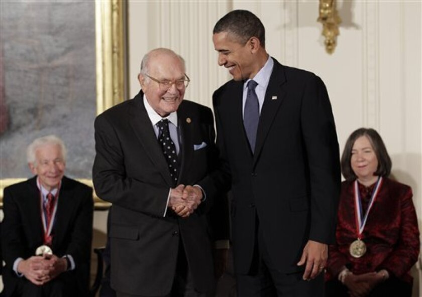 President Barack Obama stands with Harry W. Coover who invented cyanoacrylate glue, commonly known as Super Glue, for Eastman Chemical Co., as he hosts a ceremony for recipients of the National Medal of Science and the National Medal of Technology and Innovation, the highest honors bestowed by the