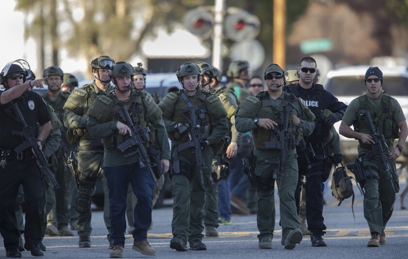 SWAT officers search for suspects in the San Bernardino mass shooting in the sort of image that is becoming commonplace on our televisions.