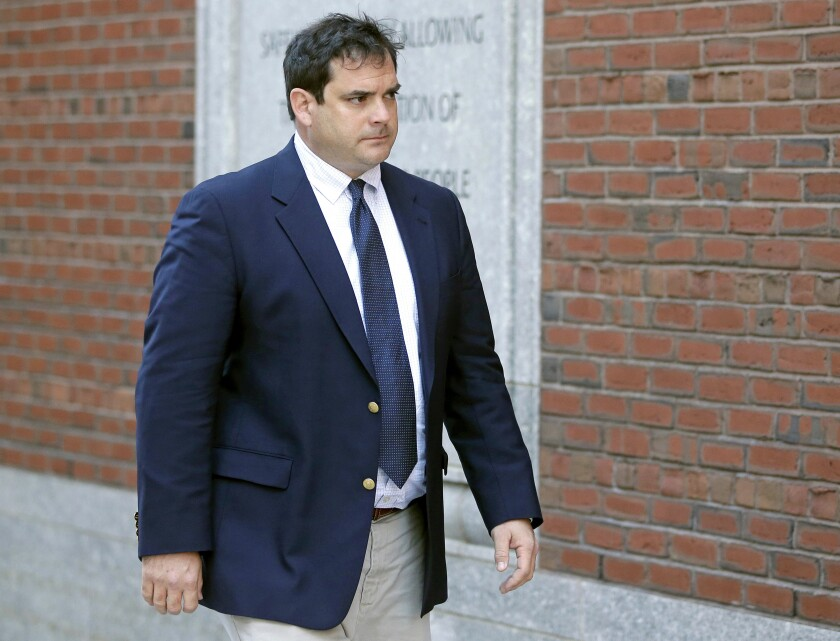 FILE - In this March 12, 2019 file photo, John Vandemoer, former head sailing coach at Stanford, arrives at federal court in Boston to plead guilty to charges in a nationwide college admissions bribery scandal. Stanford University says it conducted a review that found the mastermind behind the college admissions bribery scandal had approached seven coaches about potential sports recruits over the past decade. Only one of them, Vandemoer, went along with the scheme proposed by college consultant Rick Singer, it says. Stanford also says it has adopted new policies to strengthen admission oversight. (AP Photo/Steven Senne, File)