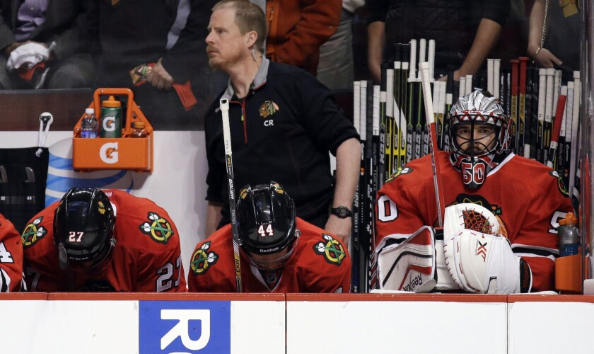 Chicago Blackhawks players look down near the end of Game 3 of the Western Conference finals against the Ducks.