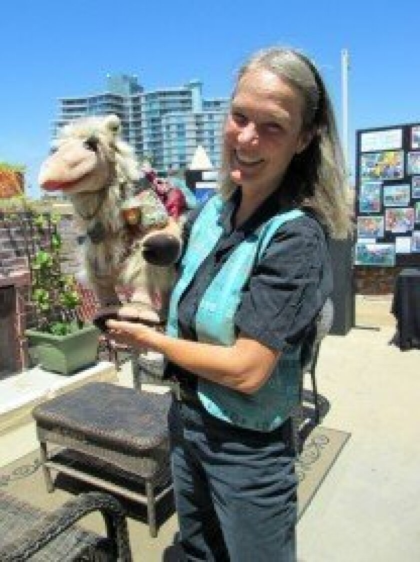 Mary Johnson Powell with Camille the Camel, originally designed for the San Diego Zoo's Education Dept. Photo Lonnie Burstein Hewitt