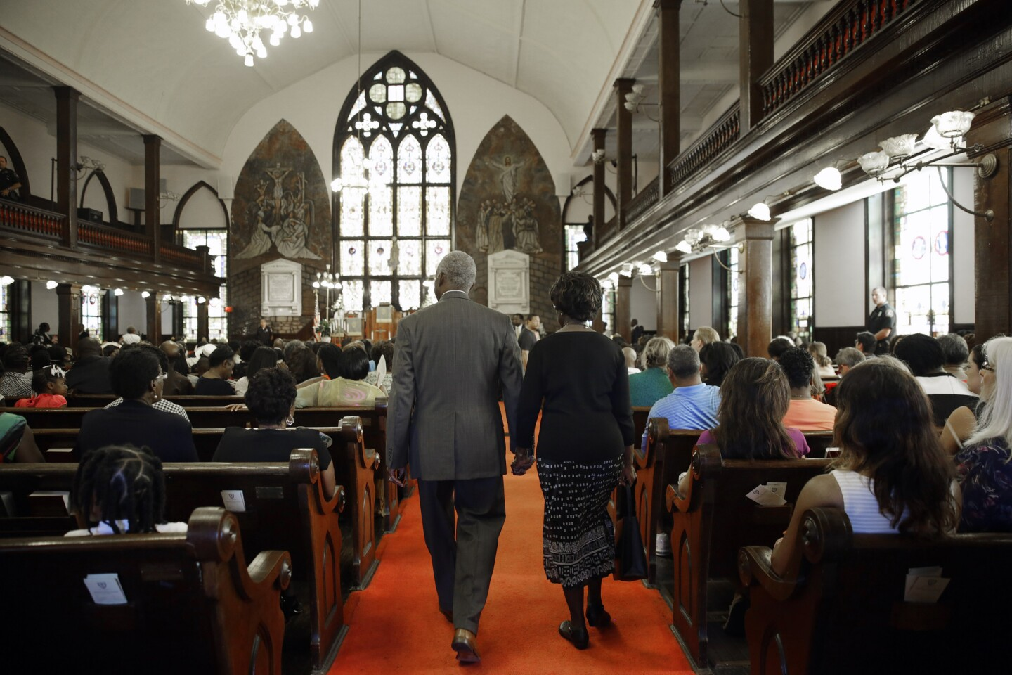 Worshipers enter Emanuel A.M.E. Church in Charleston, S.C., four days after a mass shooting that claimed the lives of its pastor and eight others.