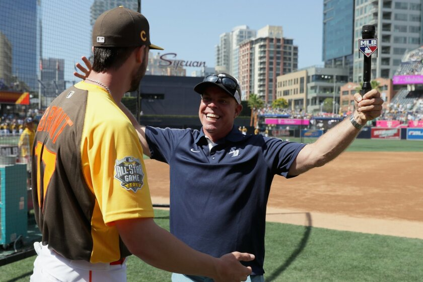 (L-R) Kris Bryant #17 of the Chicago Cubs greets University of San Diego baseball coach Rich Hill during Gatorade All-Star Workout Day for the 87th Annual MLB All-Star game at PETCO Park on July 11, 2016 in San Diego, California.