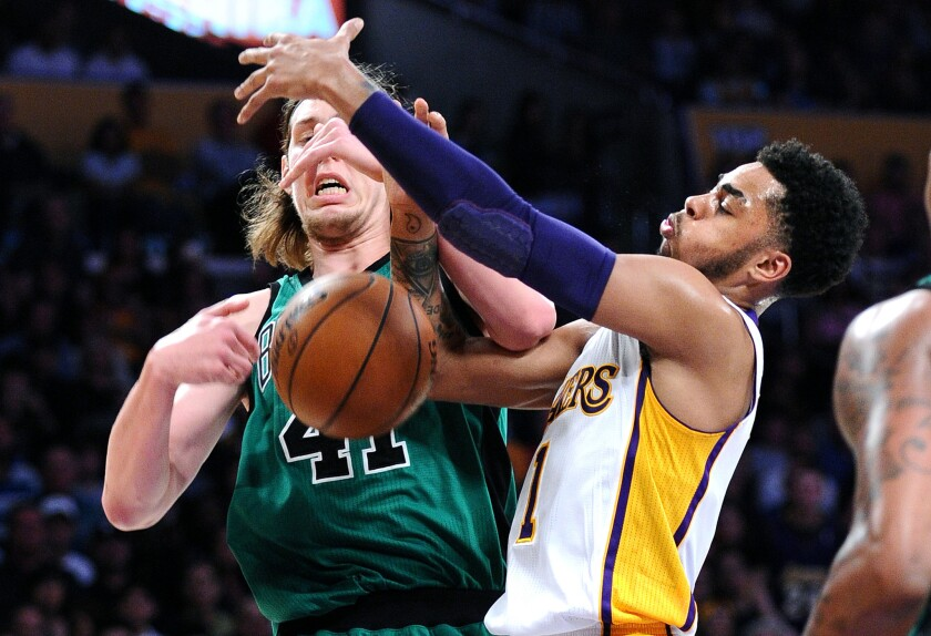 Lakers guard D'Angelo Russell, knocking the ball away from Celtics forward Kelly Olynyk during a game last season, knows that a good offense often starts with good defense.