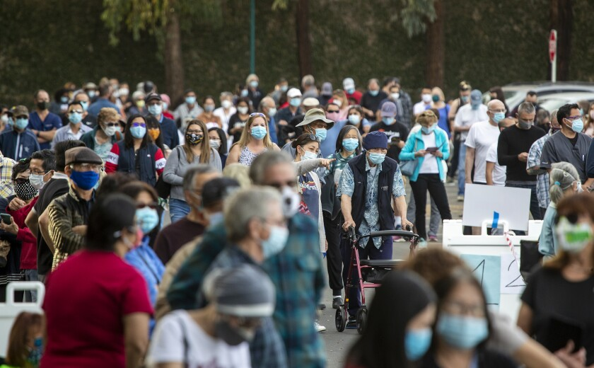 Orange County residents line up at the county's first large-scale vaccination site at a Disneyland parking lot on Jan. 13.