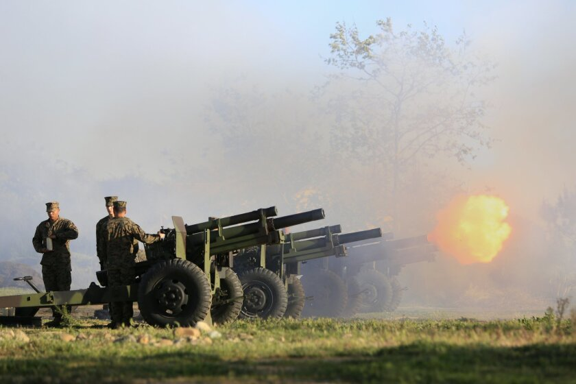 A 21-gun salute, seven canons firing three times each, commemorating the 70th anniversary of the battle of Iwo Jima.