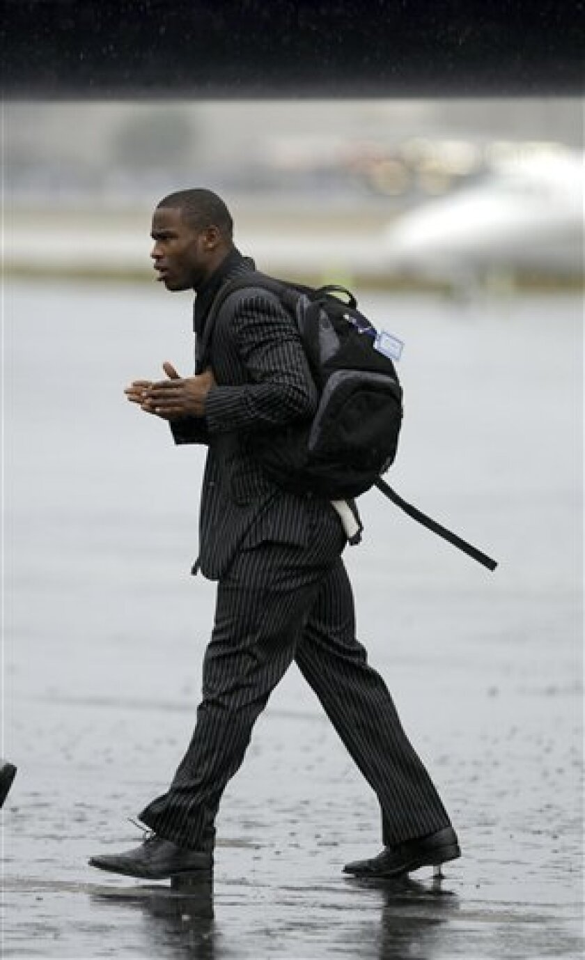 Indianapolis Colts wide receiver Pierre Garcon arrives in Fort Lauderdale, Fla., with the rest of the NFL football team Monday, Feb. 1, 2010. The Colts are scheduled to play the New Orleans Saints in Super Bowl XLIV on Sunday. (AP Photo/Charlie Riedel)