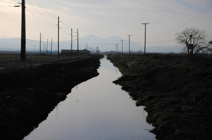 A waterway runs alongside Route 4 in the Sacramento-San Joaquin Delta region, right outside of Stockton, Calif.